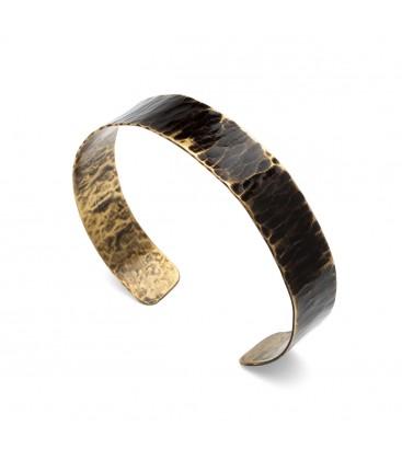 Brass bracelet with black shape