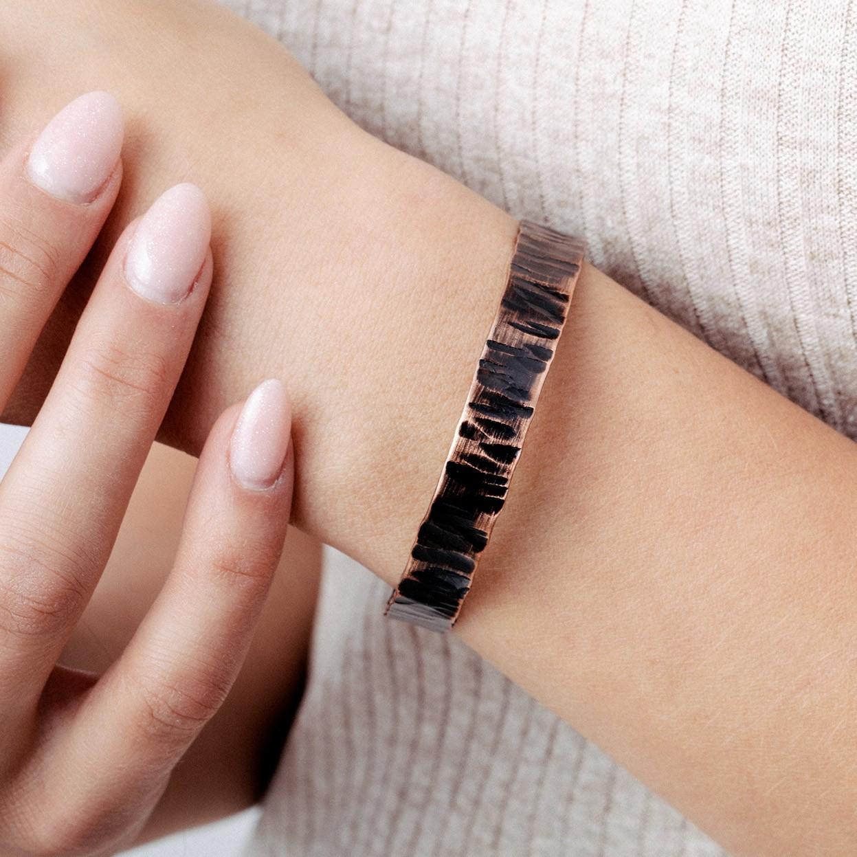 Copper bracelet with black shape