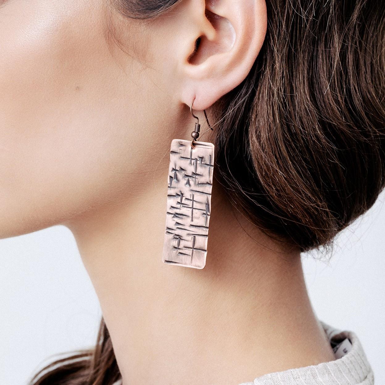 Copper earrings with cross shape